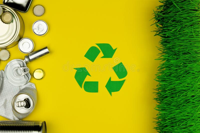 Green recycle sign with metal aluminium trash stock image