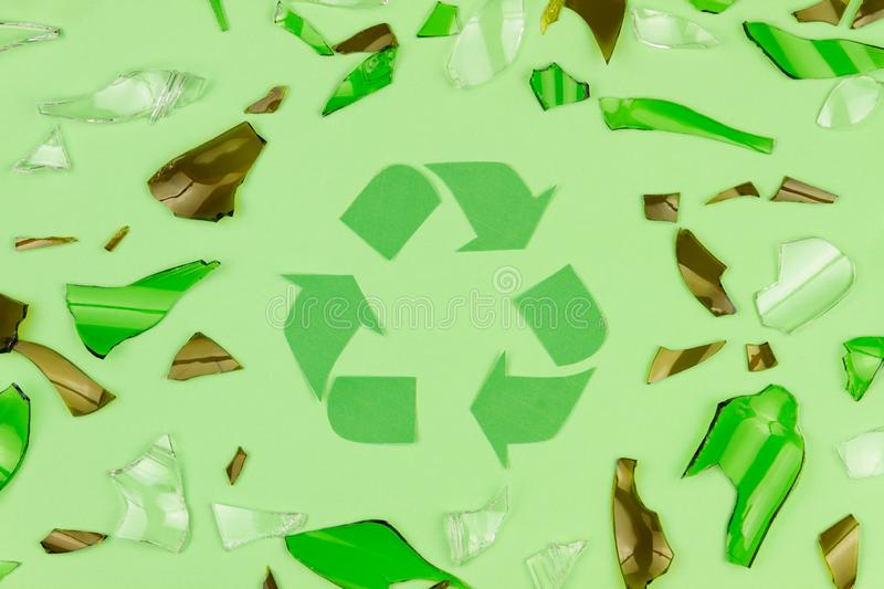 Green recycle sign symbol with shattered glass royalty free stock photography