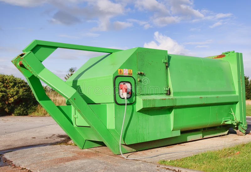 Download Green Recycle Skip With Electric Compressor Stock Photo - Image: 10347490