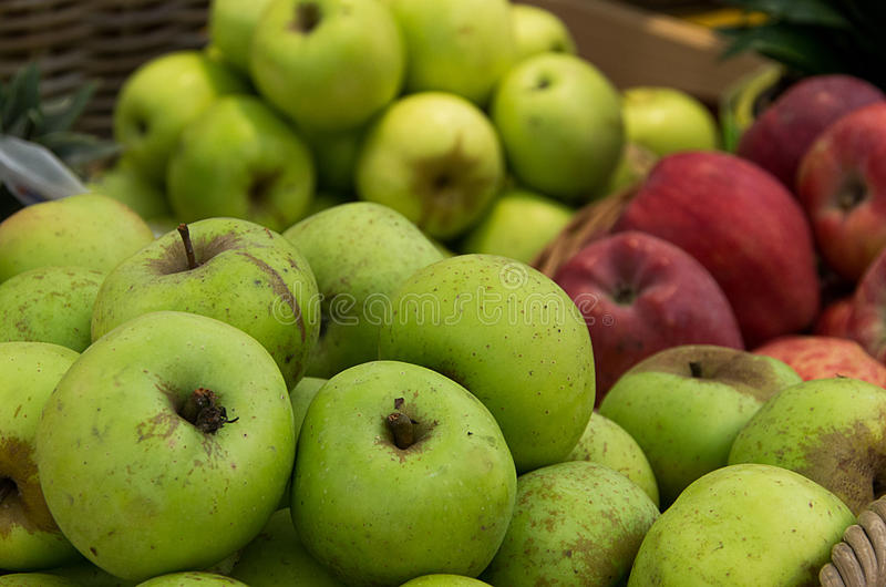 Green and red apple. In the basket royalty free stock image