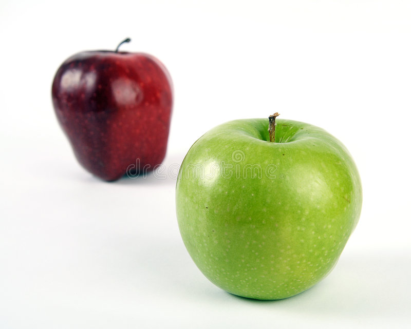 Green and red apples. On white background royalty free stock image