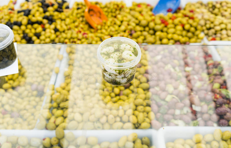 Green, red and black olives, chilies, preserves in a French market in Paris France stock photo