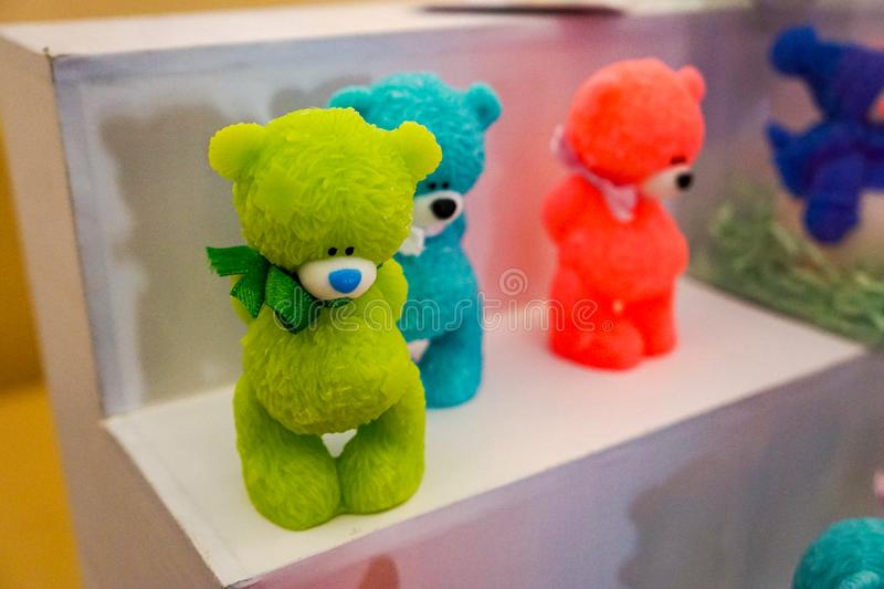 Green red blue colored soap bear cubs stock photo