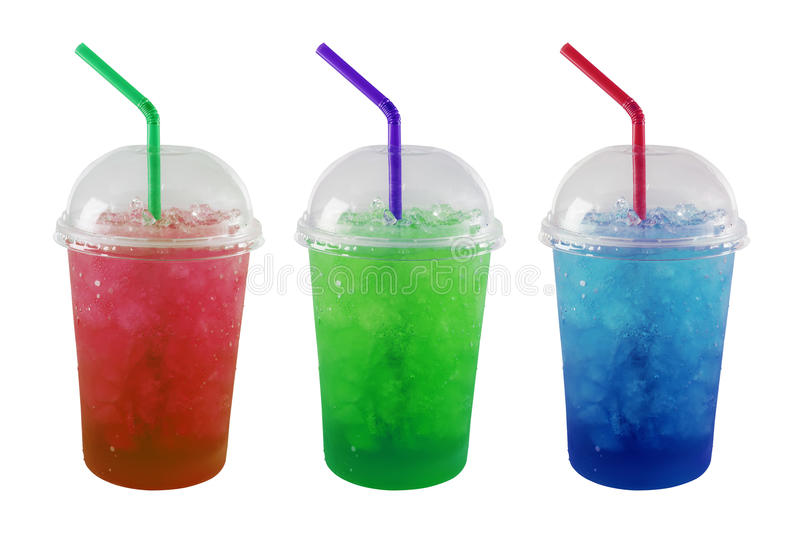 Green, Red and Blue soda and ice in plastic grass isolated royalty free stock photography