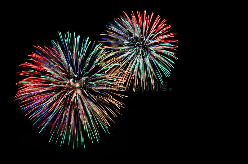 Green red blue white golden fireworks royalty free stock photography