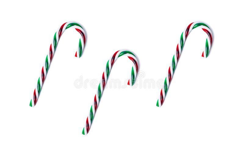 Green and red candy canes isolated on white, top view. stock photography