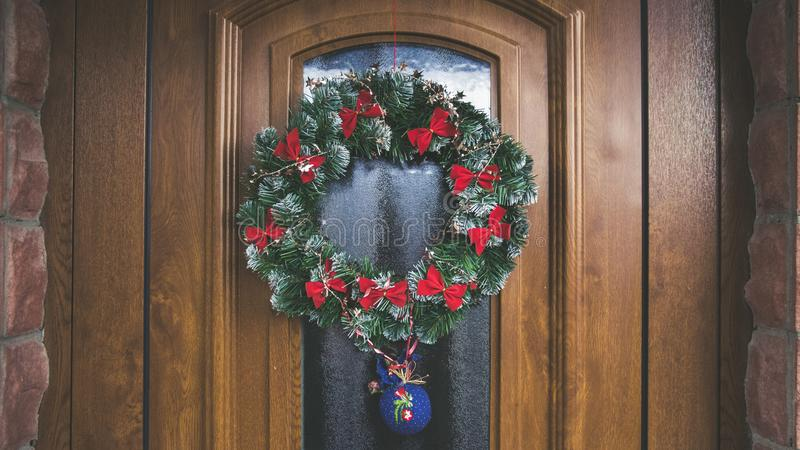 Green and Red Christmas Wreath on Door royalty free stock photos