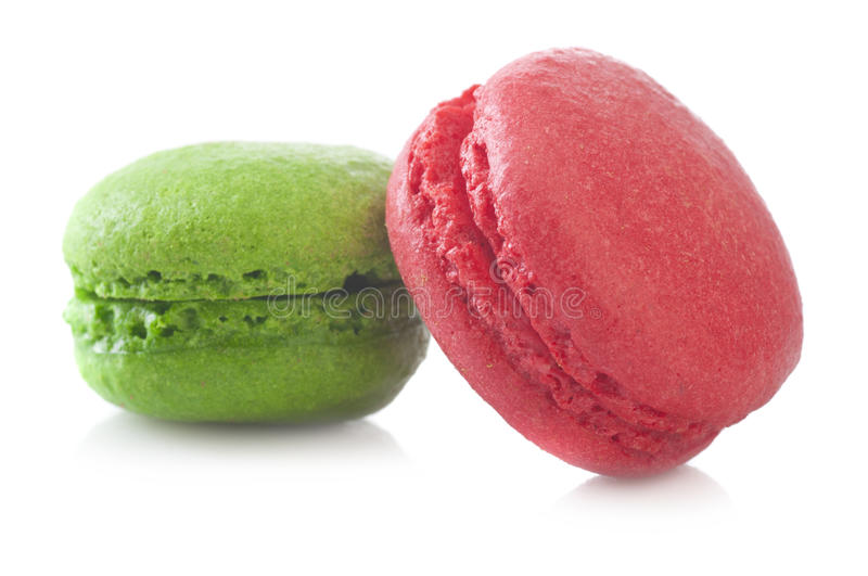 Green and red French macarons. On a white background stock images