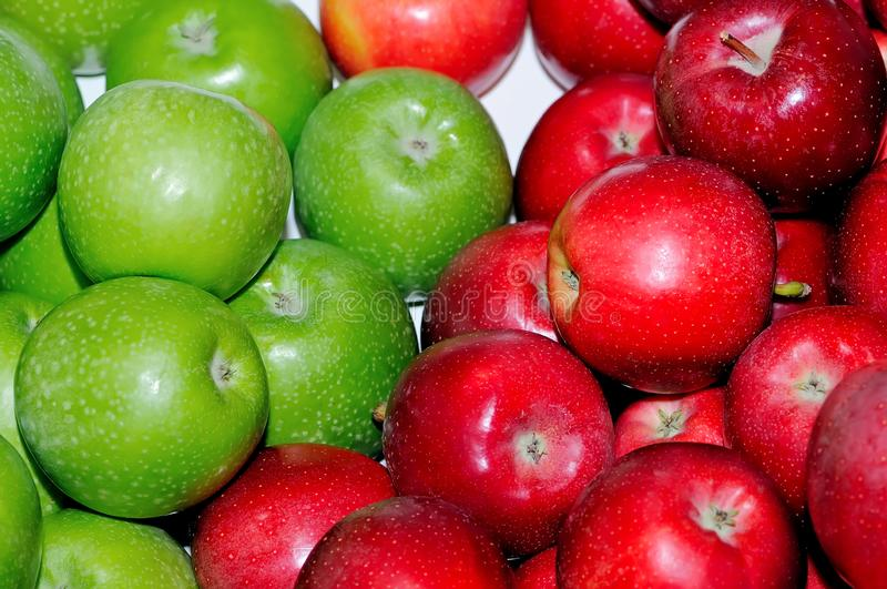 Green and red fresh apples as background stock photography