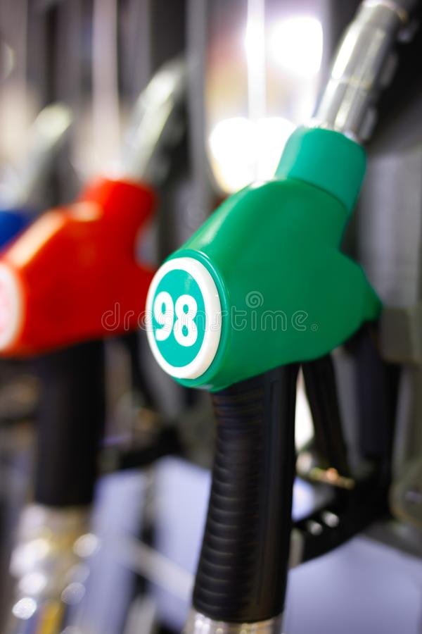 Green red fuel pistols on fuel station stock photography