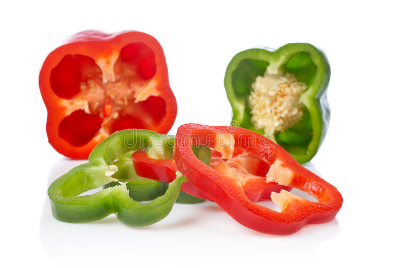 Green and red pepper slices stock image