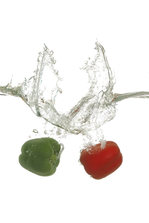 Green and Red Pepper Splash stock photography