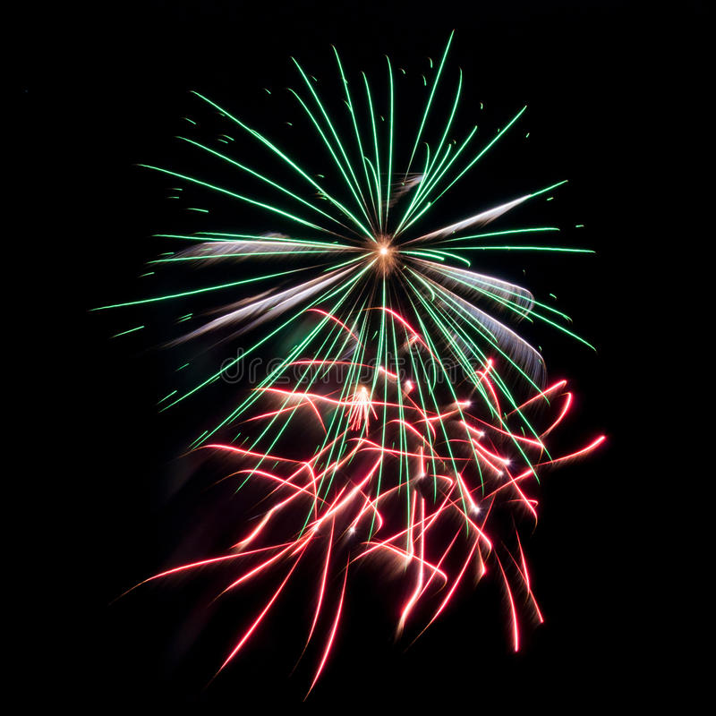 Green, red and white fireworks stock image