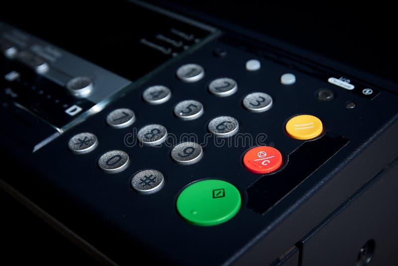 Green Start Button on a photo copier, fax, printer. Shallow focus, on work start. stock image