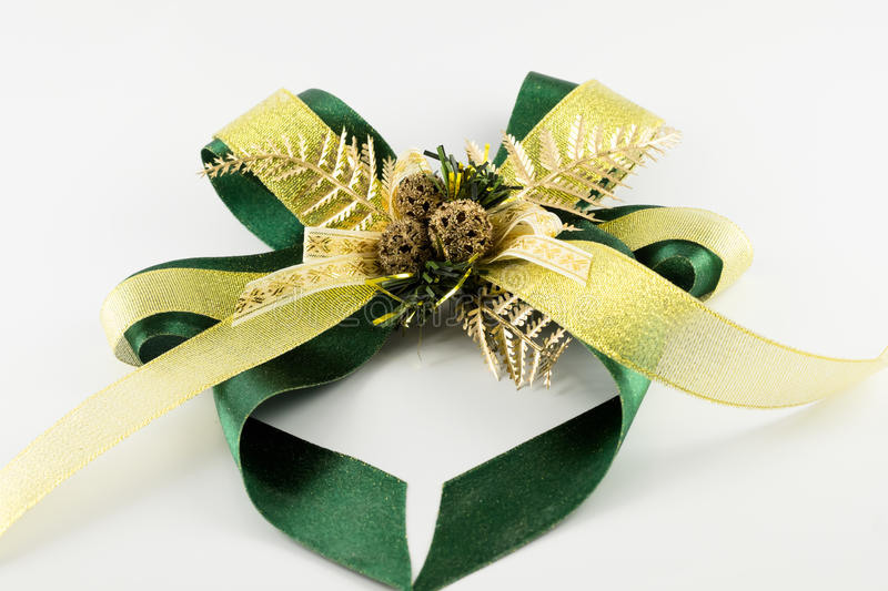 Green ribbon bow isolated on white background stock image