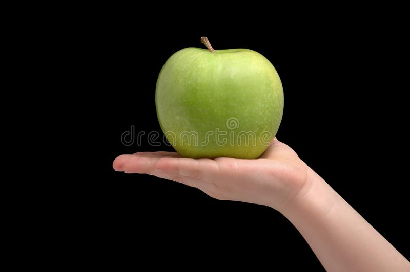 Green ripe apple on woman palm royalty free stock images