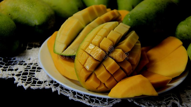 Green And Ripe Mongo With Black Background royalty free stock photos
