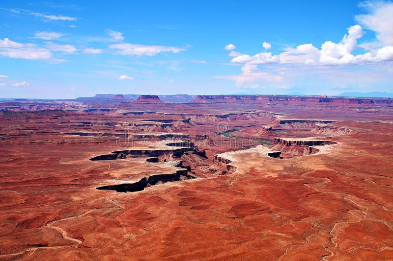 Green River canyon cutting into flat desert landscape in Canyonlands, Utah royalty free stock photo