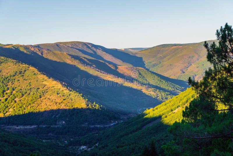 Green river Rio Zezere valley mountain panorama landscape on sunset. Portugal, Serra da Estrela stock photo