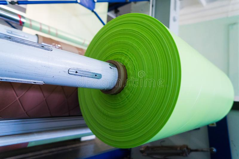 Green roll of polyethylene or polypropylene bags.  stock images