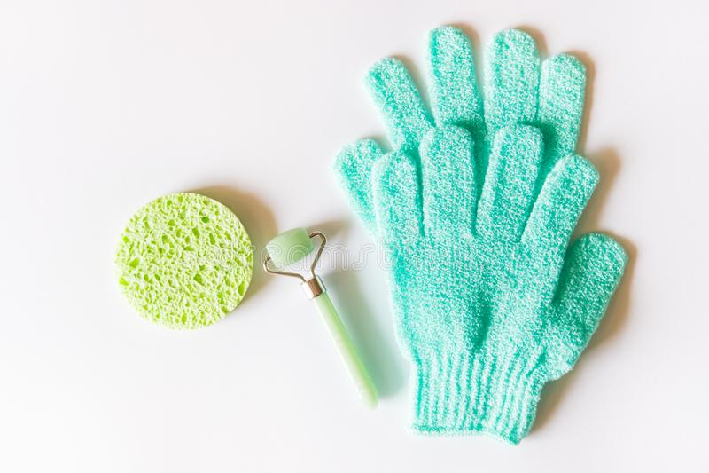 Green roller and gloves royalty free stock image