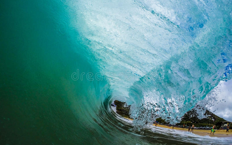 Green Room. Backlit wave on the east side of Oahu, Hawaii stock images