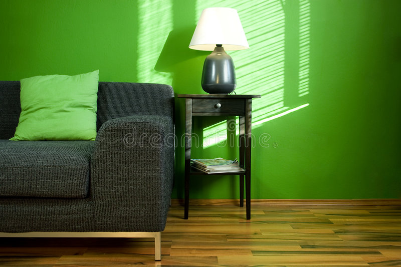Green room with sofa. Green room with black modern sofa royalty free stock photo