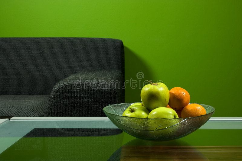 Green room with sofa. Green room, sofa and fruits in bowl royalty free stock photography