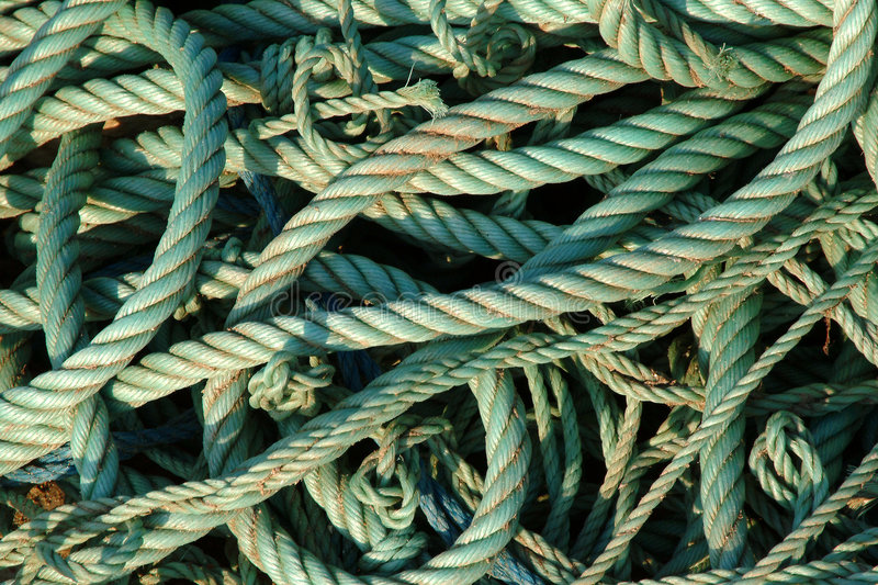 Green ropes. In port background stock photo