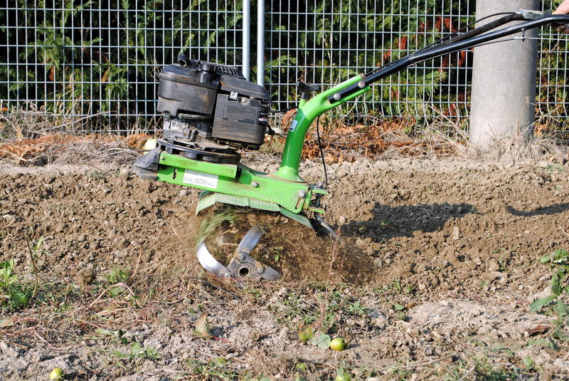 Green rotary tiller stock images
