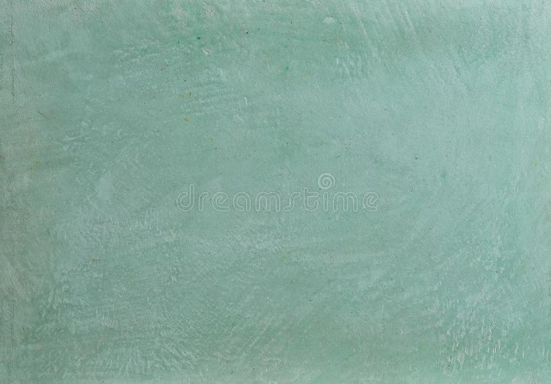 Green rough wall textured background. Abstact stucco. Texture of plaster on the wall. Macro, high resolution. Open space for your inscription. Abstract royalty free stock image
