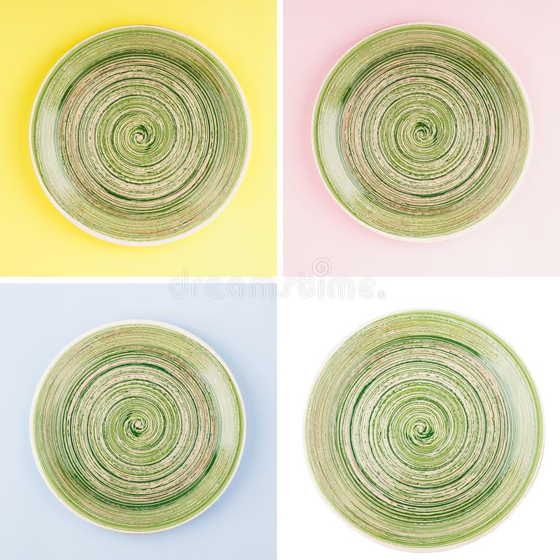 Green round ceramic plate with spiral pattern stock photography