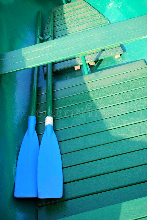 Download Green Rowboat With Blue Oars Stock Photo - Image of sport, still: 19703090