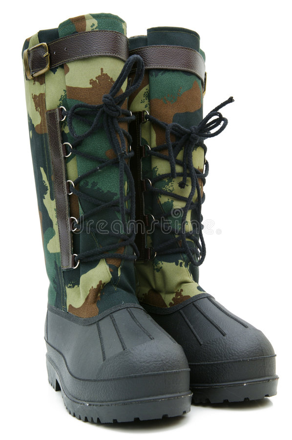 Green rubber boots isolated stock image
