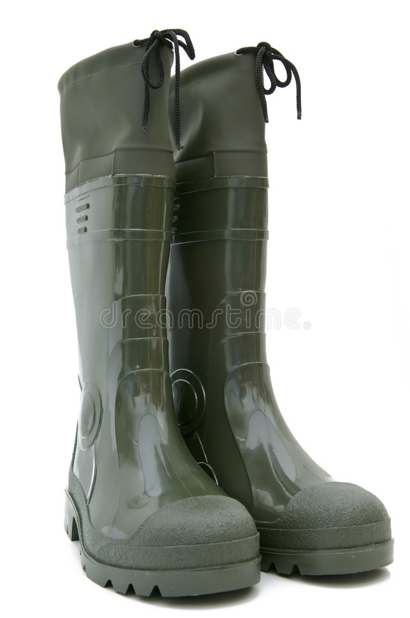 Green rubber boots isolated stock photos