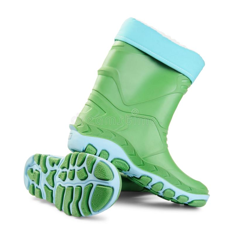 Green rubber boots on a white stock image