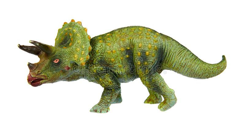 Green rubber dinosaur toy, prehistoric wild animal. Isolated on white background, triceratops, beast, strength, strong, power, monster, jurassic, reptile royalty free stock images