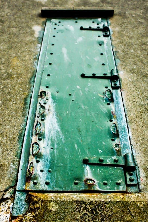 Green rusty door 2 stock photo