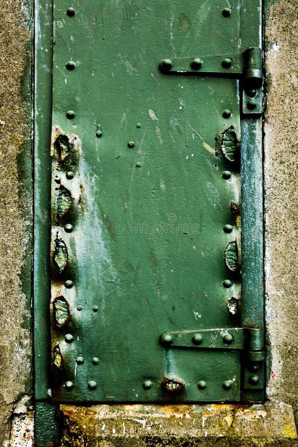 Green rusty door stock photo