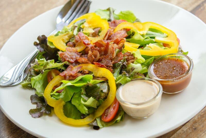 Green salad with bacon stock photos
