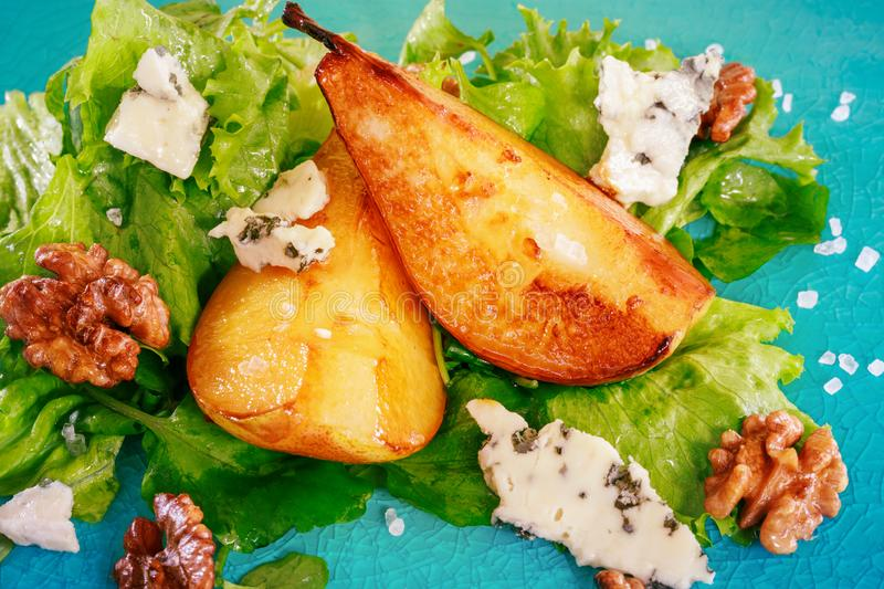 Green salad with caramelised pears,walnuts and blue cheese royalty free stock photography