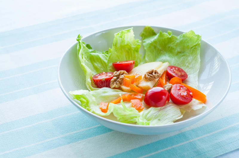 Green salad. A healthy green salad in white bowl royalty free stock image