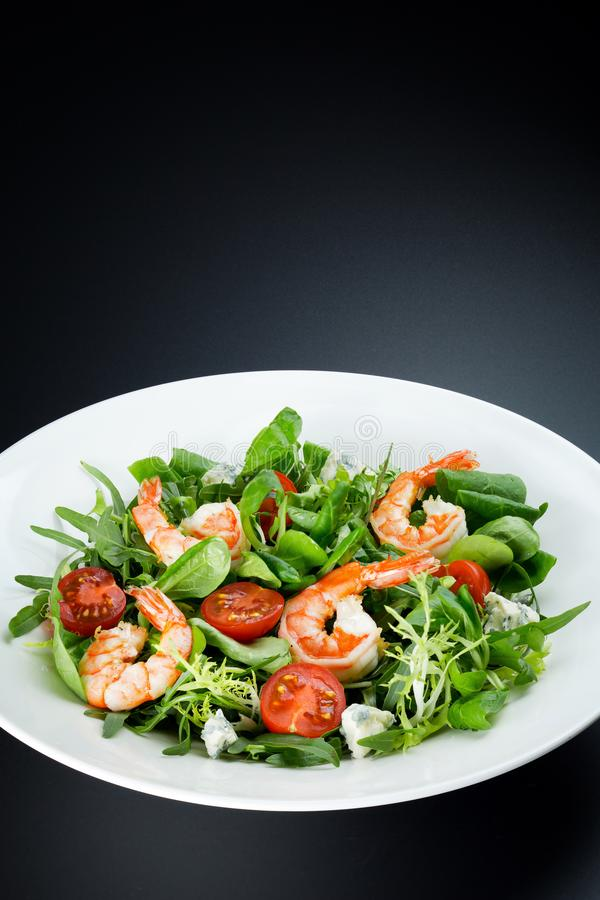 Green Salad with king prawns and tomatoes royalty free stock photos