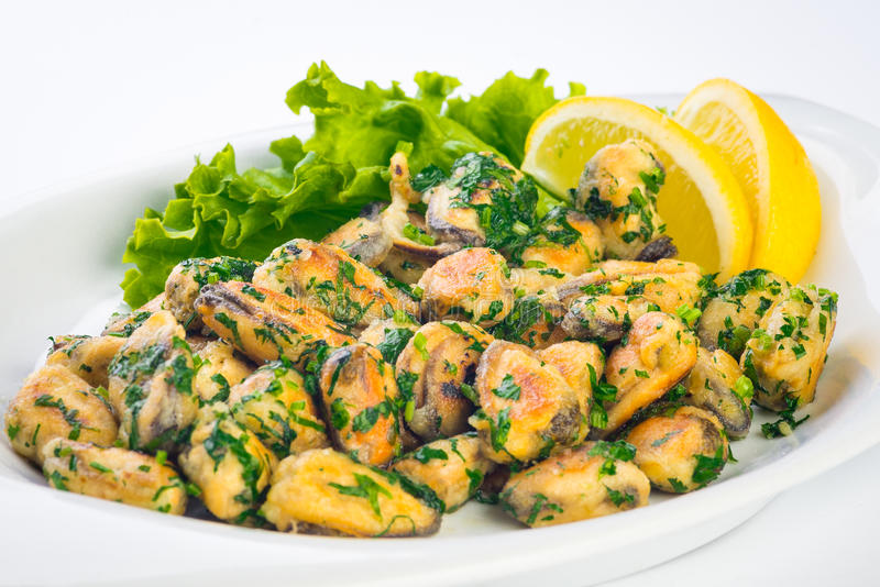 Green salad with sea food ingredients. Fried Mussels stock image