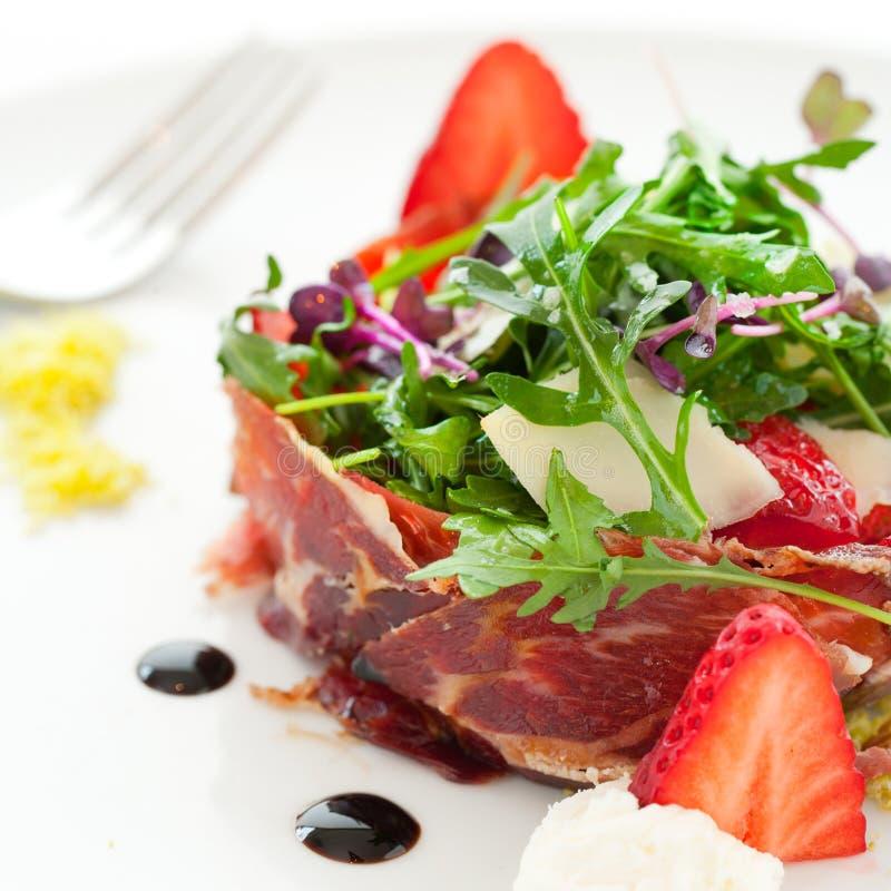Green salad with spanish ham. Macro close up of green salad with spanish pork ham royalty free stock image