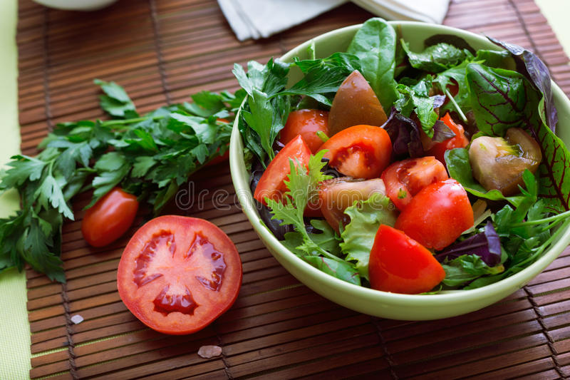Green salad with tonatoes royalty free stock images