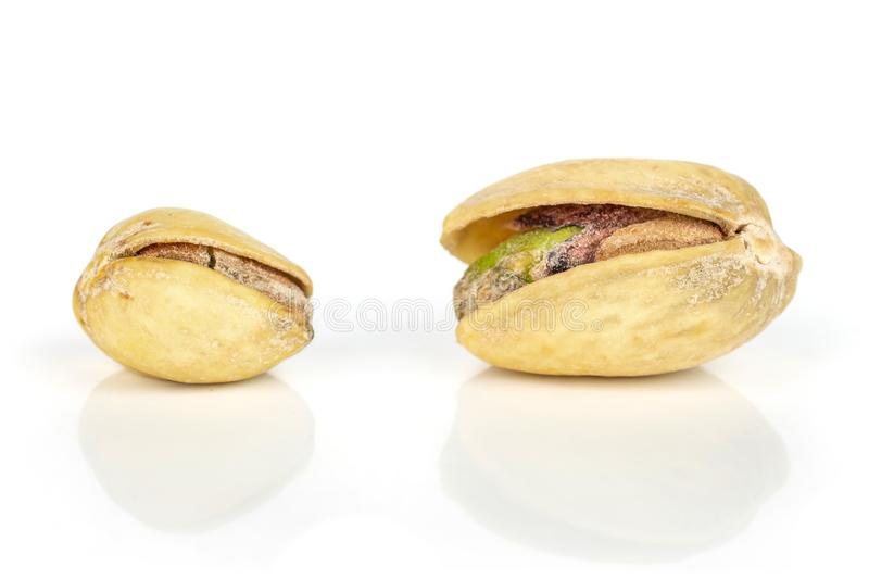 Green salted pistachio isolated on white stock photo