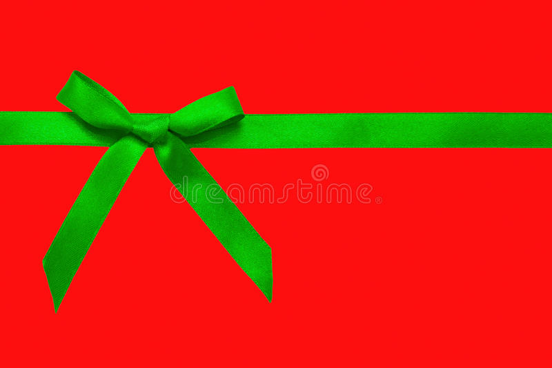 Download Green satin bow on red stock photo. Image of party, holiday - 27672614