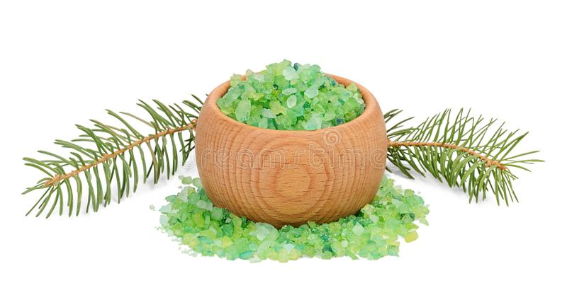 Green sea salt for bathing in wooden bowl and fir branches behind royalty free stock photos