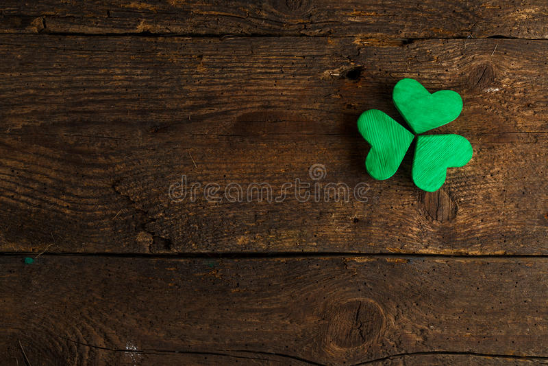 Green shamrock clovers on wooden background. Background for St. Patrick's Day celebration stock photography